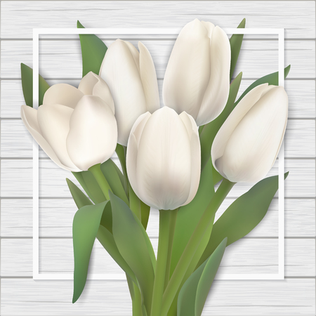 White tulips bouquet and frame on wooden background.