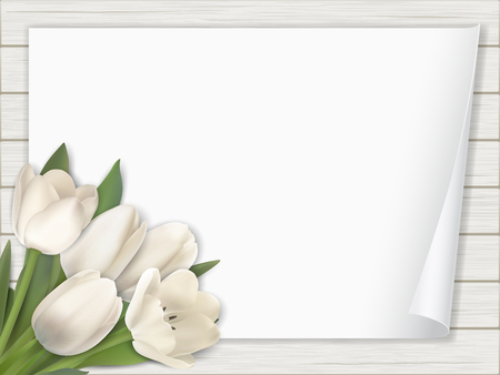 Tulip flowers bouquet and and a sheet of paper with a twisted angle on white wooden background.