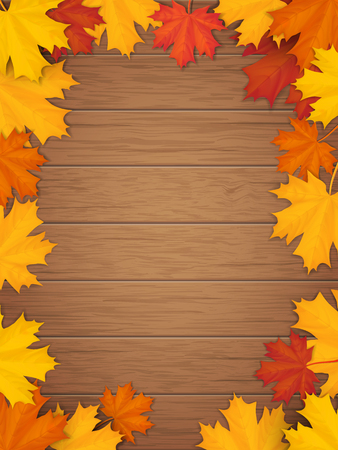 Autumn leaves on wooden background. Frame from fallen maple leaf. Template for a seasonal sale, invitation or advertisement card with empty space for text.