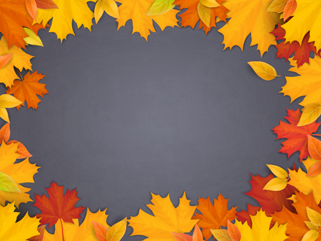 Fallen maple leaves on black chalkboard background. Welcome back to school background with space for advertising text.