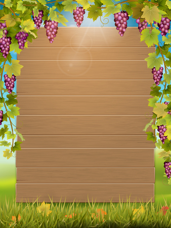 Wooden signboard decorated with grape bunch on autumn landscape background. Template for the harvest festival card or invite.