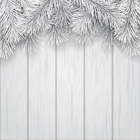 White artificial Christmas tree branches on wooden background. Template for christmas greeting card or winter sale banner.