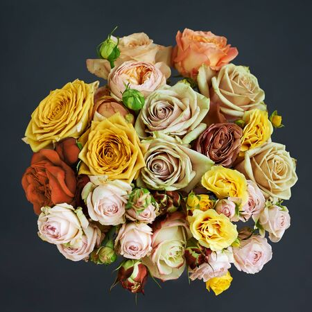 Bouquet of beautiful rose flowers. Top view on a dark background.