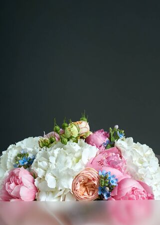 Bouquet of beautiful rose flowers on a dark background.