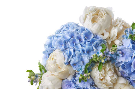 Background with beautiful bouquet of flowers peonies. White peonies and blue hydrangea flowers on white background, isolated. Design for greeting card or invitation.