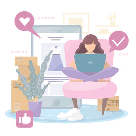 The girl makes purchases of clothes online in the online store, sitting at home on the sofa.
