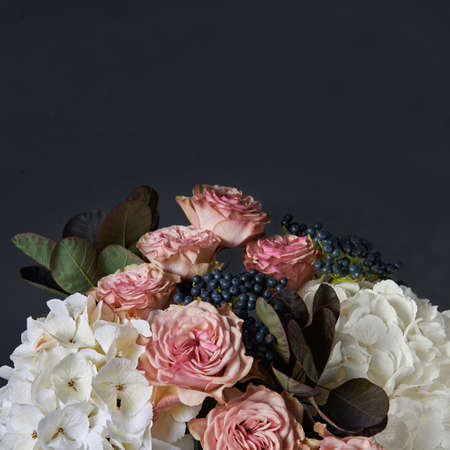 Autumn bouquet of white hydrangea, red calla and pink chrysanthemum. Background for a greeting card. Dark background.