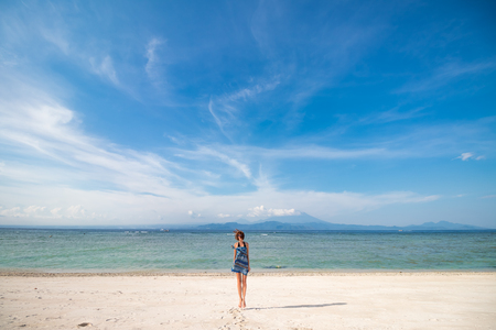 nusa: Happy girl jumping on the beach wit white sand. Tropical island Nusa Lembongan.