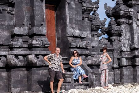 god box: Two caucasian women in sunglasses and one man near the balinese temple. Explore Indonesia. Stock Photo
