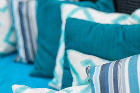 red sofa: Colorful pillows on a blue sofa. Stock Photo