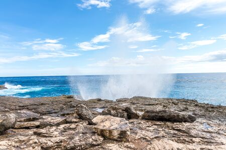 Powerful Waves on a rocky beach, waves splashes. Nusa Lembongan, Bali, Indonesia. Stock Photo