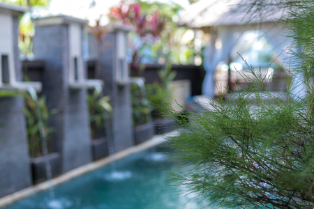 Swimming pool for rest and swimming. Tropical luxury villa on Bali island, Indonesia.