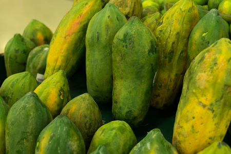 Green fresh Papaya in the local organic market of tropical Bali island, Indonesia. Asia. Papaya background. Stock Photo
