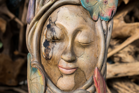 Face wood handmade.Sculpture on the tropical Bali island, Indonesia. Wood carving, art village. Stock Photo
