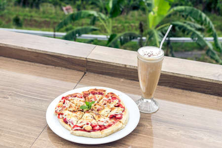 studioshoot: Delicious strawberry pizza on a balinese tropical nature background. Bali island.