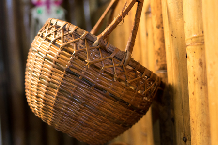 wood texture: Empty handmade wooden basket in the traditional shop of Bali island, Indonesia. Handcraft basket.