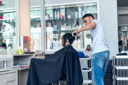 BALI INDONESIA JUNE Hair Stylist At Barber Shop On - Hairstyle barbershop indonesia