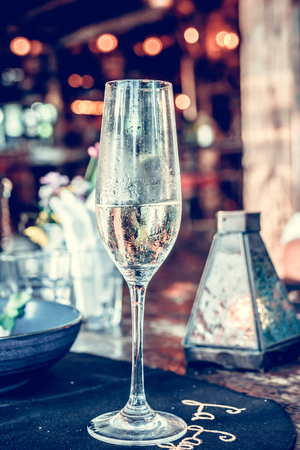 Close up of a glass of champagne in cafe, Bali island, Indonesia.