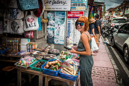 BALI, INDONESIA -JANUARY 1, 2017: Young woman on the souvenir street of Ubud, Bali, Indonesia. Editorial