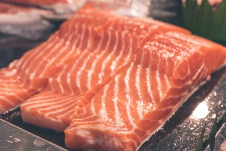 cutting: Close up meat texture of raw salmon fillet. Raw salmon atlantic fish on the local food market on Bali island, Indonesia.