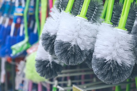 Toilet brushes hanging in the store. Bali island. Standard-Bild
