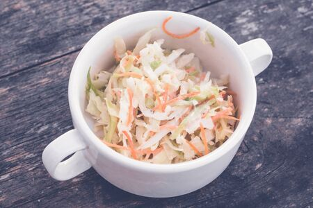 Fresh organic salad with cabbage and carrots. Healthy fresh vegetable salad.