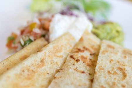 Homemade Quesadilla with chicken in the plate close-up shot, Bali island. Stock Photo