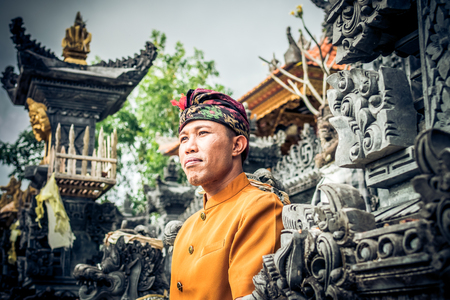 ubud: Close up portrait of balinese indonesian man posing at the tradtional temple. Tropical Bali island. Stock Photo