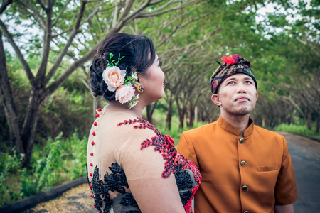 Lovely honeymoon balinese couple in traditional clothes together in nature. Bali island. Asia. Stock Photo
