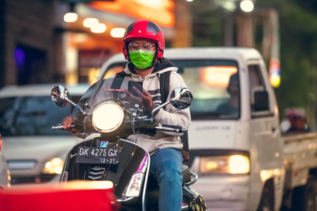 BALI, INDONESIA - OCTOBER 12, 2017: Scooters on the Legian street, Kuta Bali Motorbike traffic