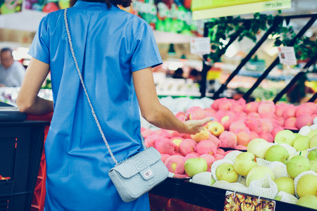 consumerism: BALI, INDONESIA - OCTOBER 2, 2017: Young woman at supermarket Bali Gallery, Bali island