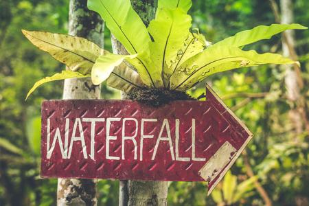Waterfall sign in the jungle of Bali island. Stockfoto