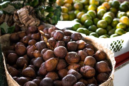 Tropical fruit, salak snake fruit on organic market in Asia.