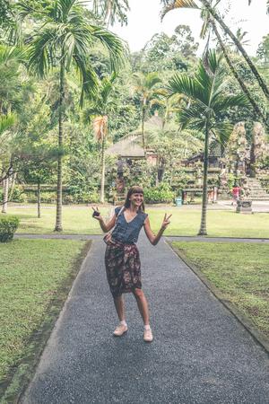 European woman in balinese temple. Bali island. Stock Photo
