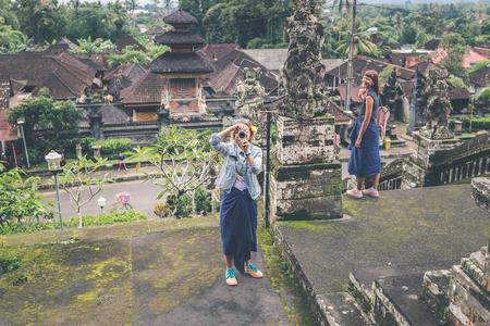 BALI, INDONESIA - JANUARY 23, 2018: European woman in balinese temple. Bali island.