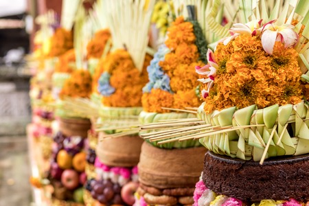 Traditional balinese offerings to Gods with fruits in basket.