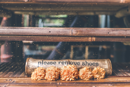 Please Remove shoes wooden sign plate. Bali.