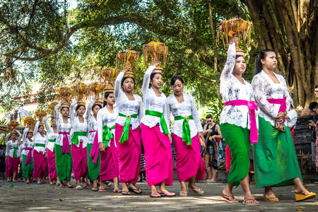 BALI, INDONESIA - SEPTEMBER 25, 2018: Balinese women in traditional clothes on a big ceremony in famous Tirta Empul Temple.