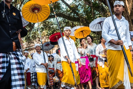BALI, INDONESIA - SEPTEMBER 25, 2018: Balinese men in traditional clothes on a big ceremony in Tirta Empul Temple.