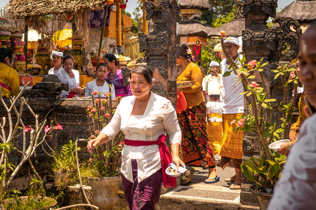 BALI, INDONESIA - OCTOBER 3, 2018: Balinese woman in traditional clothes on village ceremony. Indonesia, Bali. Stock Photo - 119935157