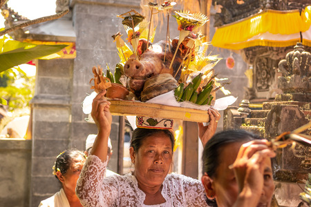 BALI, INDONESIA - OCTOBER 3, 2018: Balinese woman in traditional clothes on village ceremony. Indonesia, Bali. Editorial