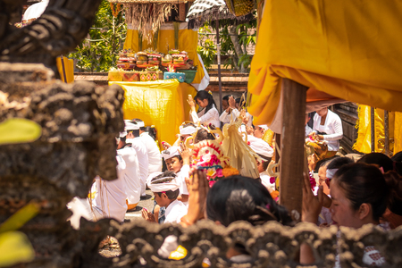 BALI, INDONESIA - OCTOBER 3, 2018: Balinese people on traditional ceremony in desa Pejeng.