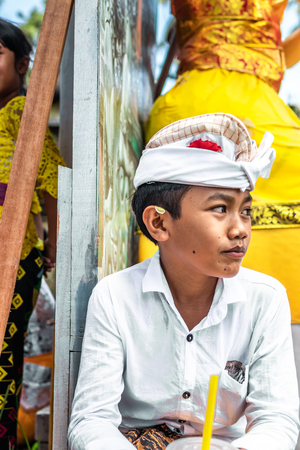 BALI, INDONESIA - OCTOBER 9, 2018: Balinese boy in traditional clothes on culture ceremony, Ubud, Gianyar.