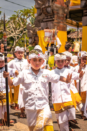 BALI, INDONESIA - OCTOBER 3, 2018: Balinese boys ritual dance in traditional costume on a balinese family ceremony in desa Pejeng Kangi. Stock Photo - 119935333