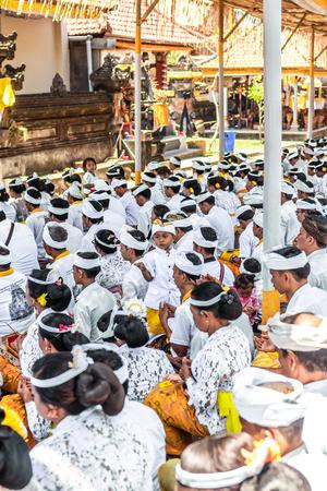 BALI, INDONESIA - OCTOBER 9, 2018: Balinese people praying on a big ceremony in Ubud, Pejeng.