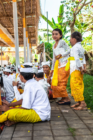 BALI, INDONESIA - OCTOBER 9, 2018: Small girl on a balinese traditional ceremony. Editorial