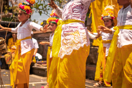 BALI, INDONESIA - OCTOBER 3, 2018: Balinese girls dancing in traditional costume on a balinese family ceremony in desa Pejeng Kangi. Stock Photo - 119935381