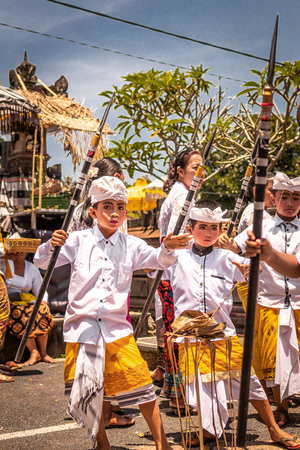 BALI, INDONESIA - OCTOBER 3, 2018: Balinese boys ritual dance in traditional costume on a balinese family ceremony in desa Pejeng Kangi.