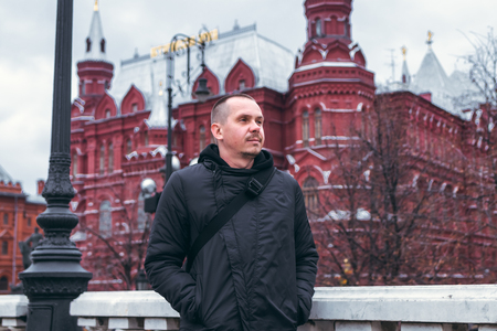 Young man on a russian red square background close to Kremlin. Moscow city.