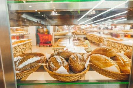 Closeup of bread in the bakery shop. Fresh bread. Organic bread background. Bali island. Banco de Imagens
